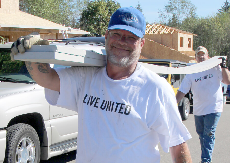 ATS partners Jerry and Sjaan move building materials at the 2015 Day of Caring with Housing Hope