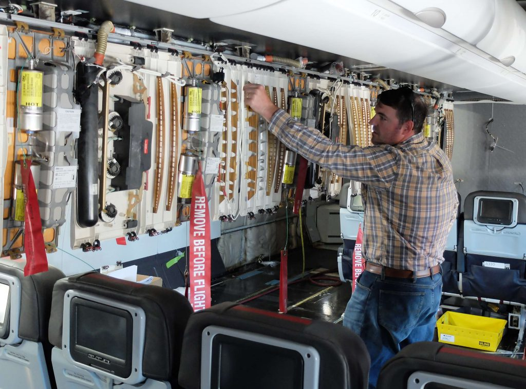 Installation and verification of avionics during post-delivery interior modifications