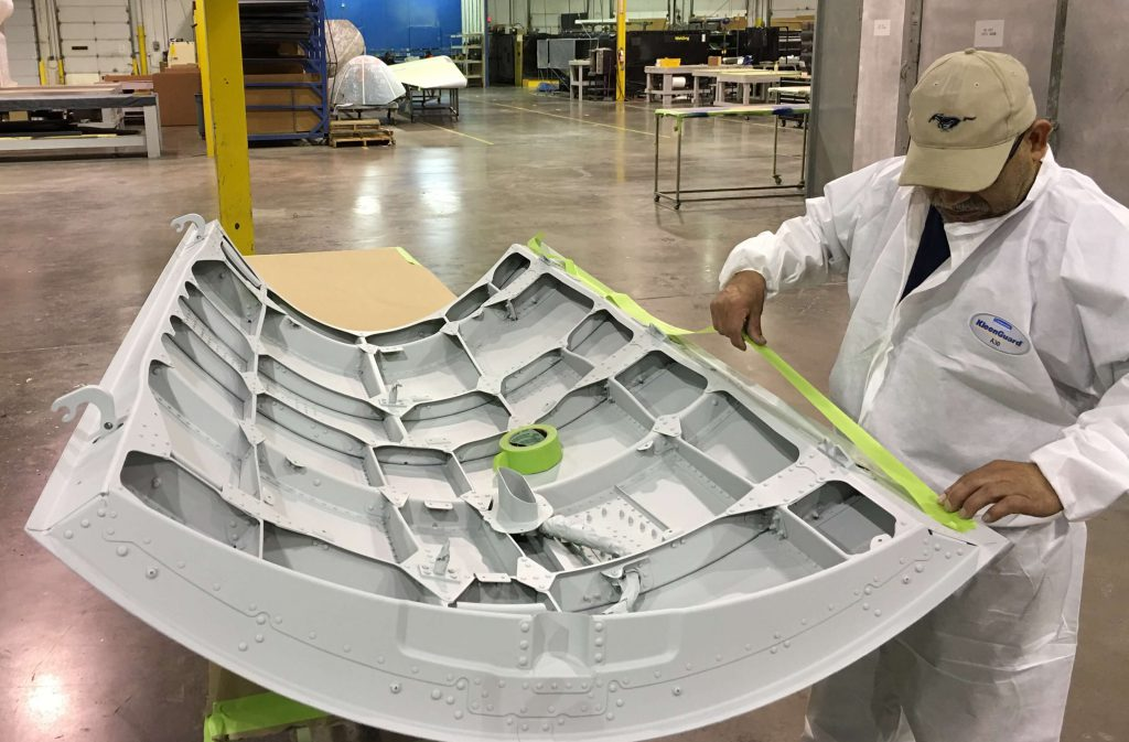 Taping interior on a B737NG APU Door  before preparing the outer surface for top coats