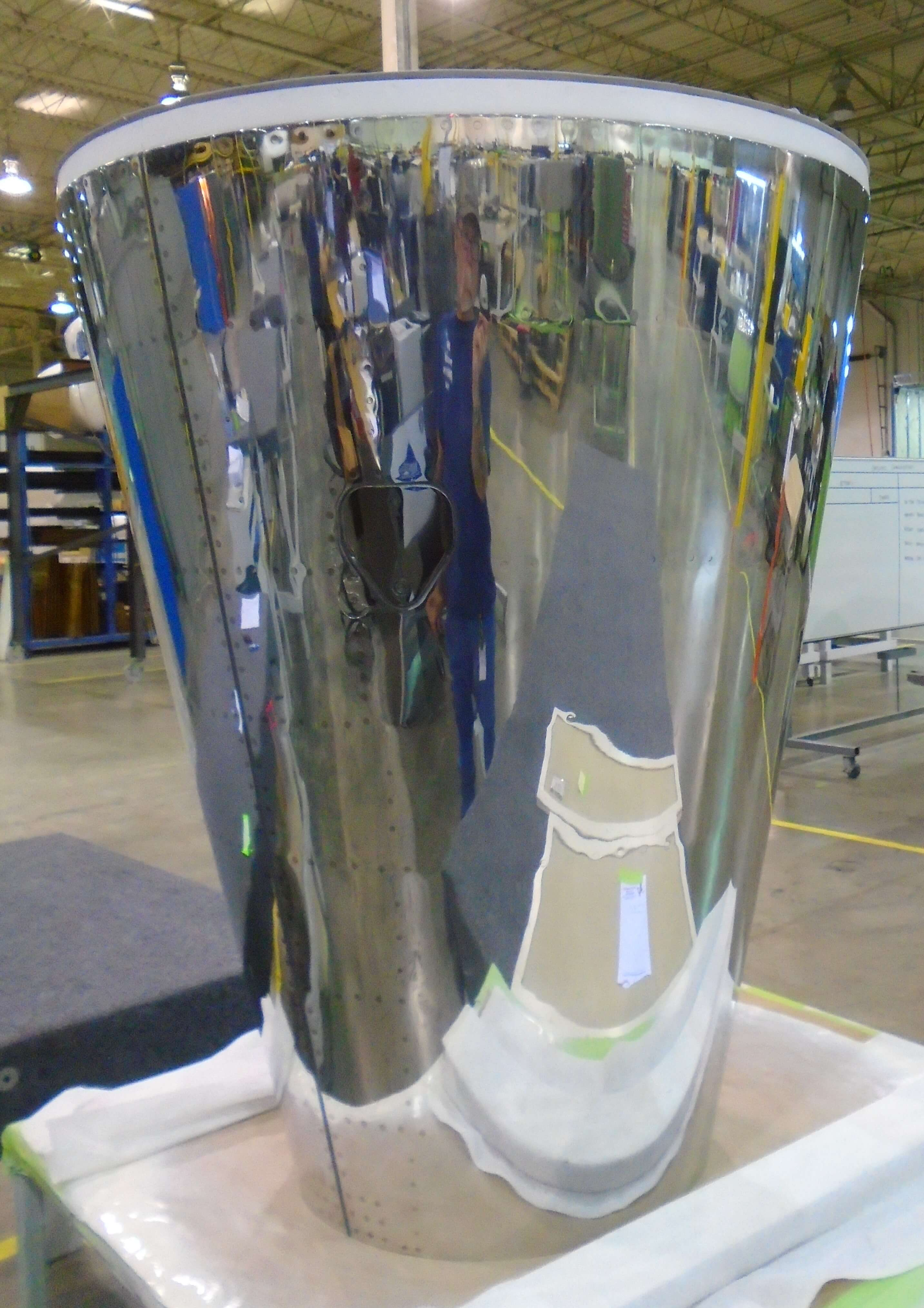 Repaired CRJ 100/200 Exhaust Nozzle undergoing Final inspection before shipping