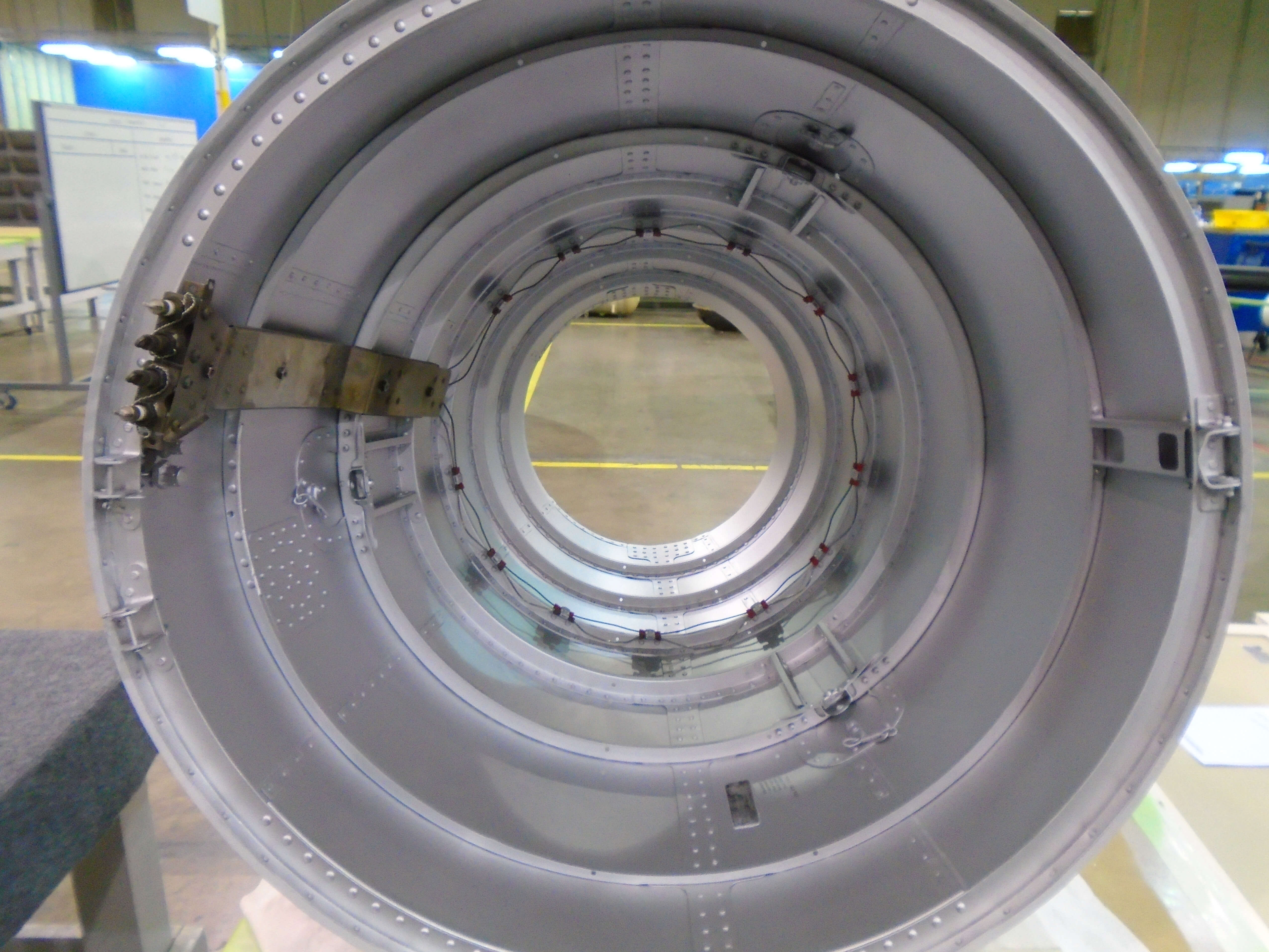 Final inspection of the inner surface of a CRJ 100/200 Exhaust Nozzle before shipping