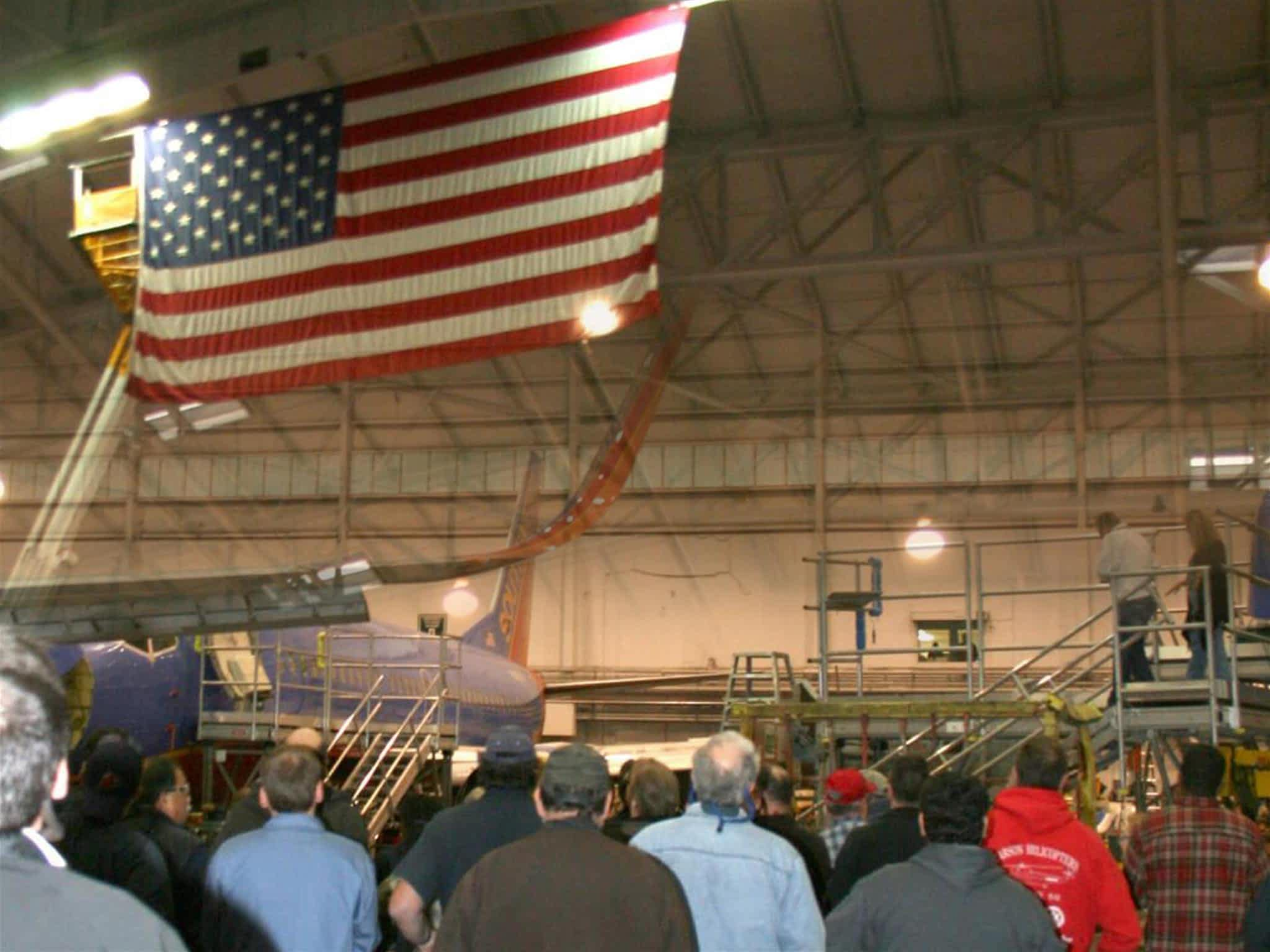 Everett flag raising in Hangar 1